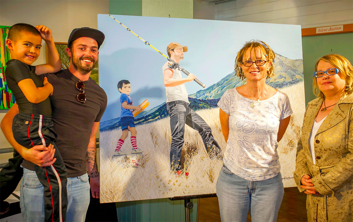 "Subjects Sam Lamott and Jax, Author Anne Lamott and Ingrid C. Lockowandt with the winning piece; ""Father and Son"" celebrating 2015 Marin Magazine's Cover Contest. Photo © Jeff Young"